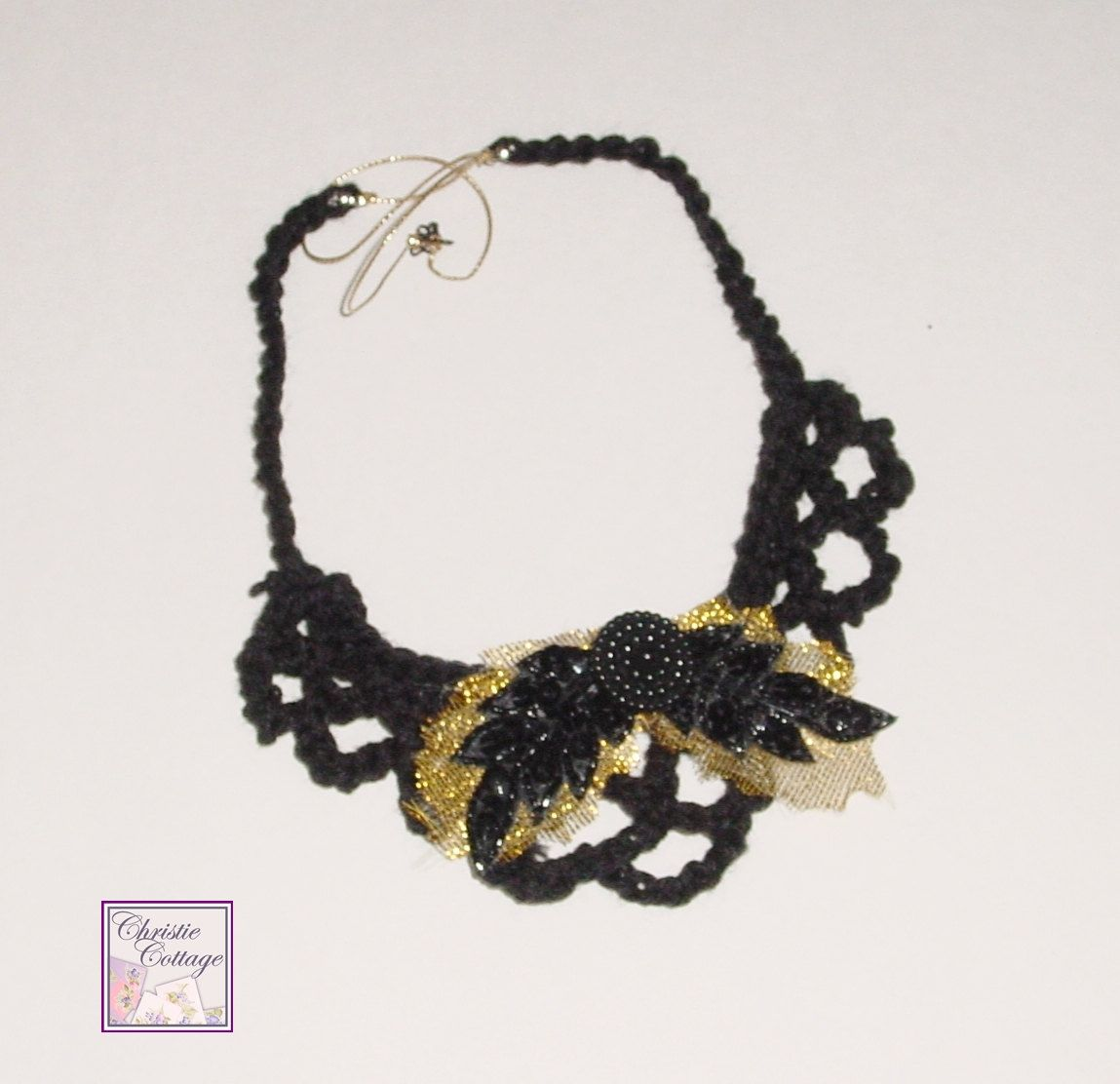 Black Bib Necklace - Gold Leaves - Black Beaded and Sequined leaves. $25.00, via Etsy.Lovely!