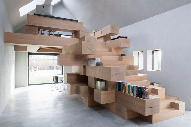Stacks Of Wood Beams Were Used To Create This Remarkable Staircase Inside An Old Barn Converted Into An Office