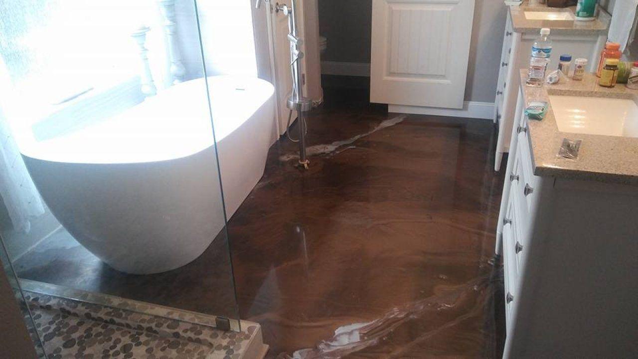 Metallic marble epoxy bathroom floor in Houston, Texas
