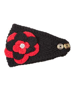 Ensembles in need of a little cheer? Start with this ultra-cozy crocheted head wrap, which boasts a dazzling blossom in contrasting hues and two craftsy buttons for an ideal fit.