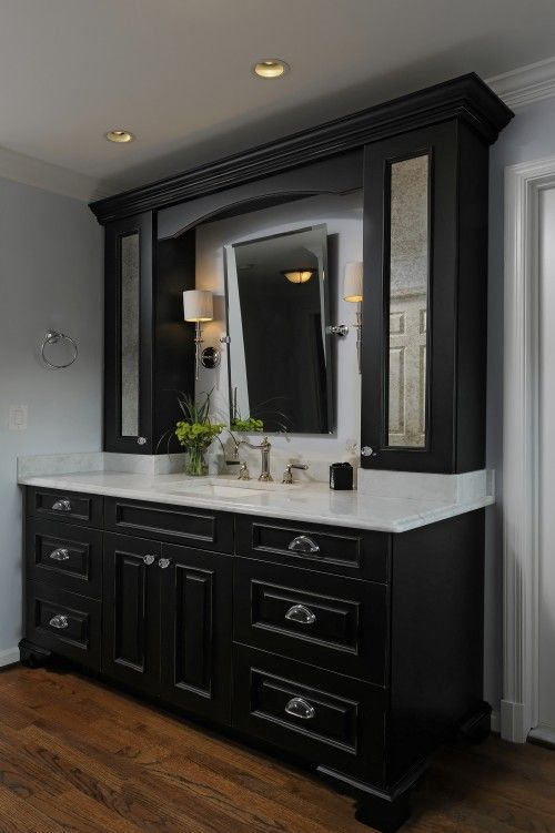 Love the tilted mirror and the dark wood