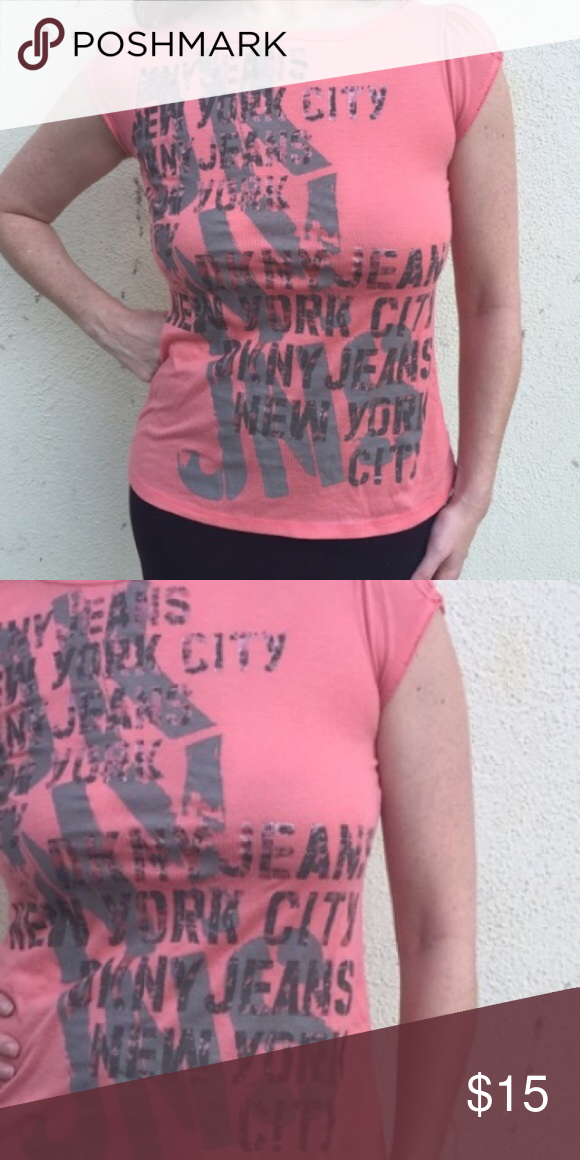 DKNY tee shirt TOP S/M long graphic PRINT NYC Great DKNY stretch t-shirt/top with lettering. Waffle texture. Longer in length, great with jeans. Coral pink color - marked as a small but fits medium as well. (S30) DKNY Tops Tees - Short Sleeve
