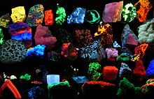 A collection of minerals fluorescing under black light