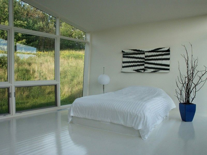 white bedroom in the country side