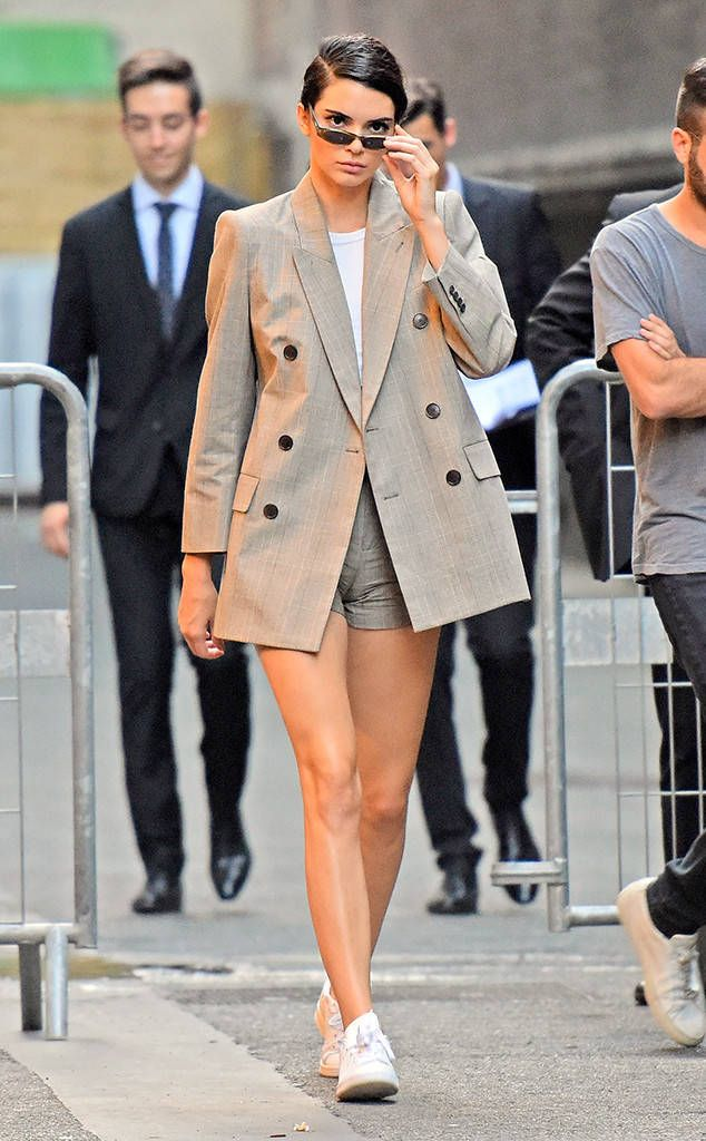 Kendall Jenner from The Big Picture: Today's Hot Photos Back to business! The model walks out of the Fendi fashion show in Paris in an oversized suit coat.