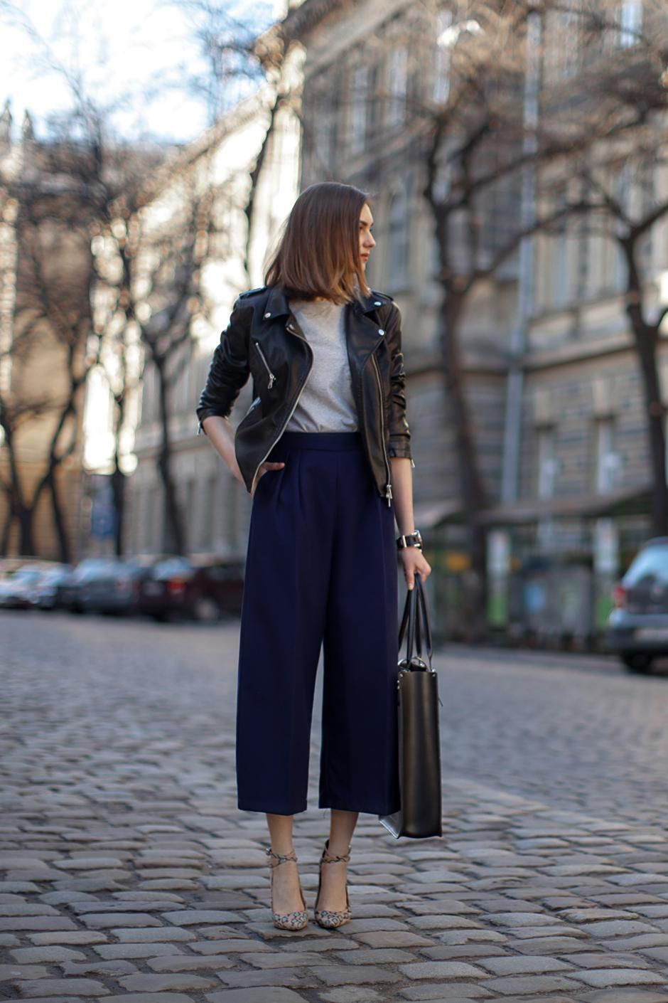 d08e8e531cd 20 Cute Spring Date Outfit Ideas - black leather jacket + navy blue, cropped  wide leg pants worn with pointy toe ankle strap heels