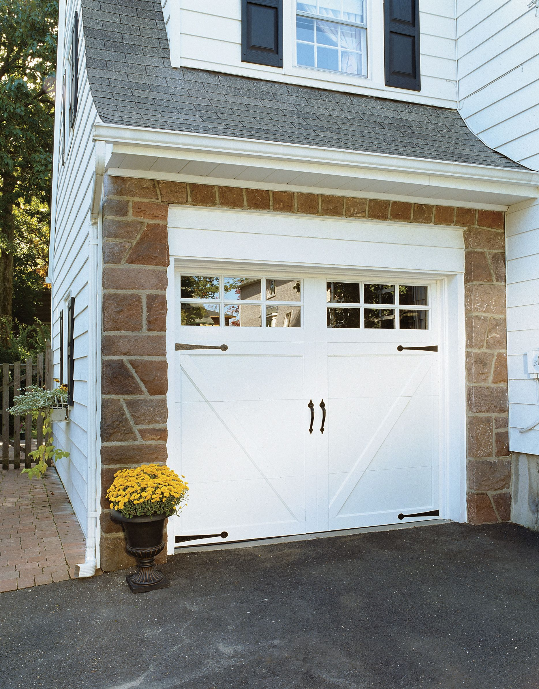 Classica northampton garage door white 9 x 8 no windows - Coastal Craftsman Cottage Featuring Clopay Coachman Collection Carriage House Garage Door Design 12 With Rec13 Windows In White Www Clopaydoor Com