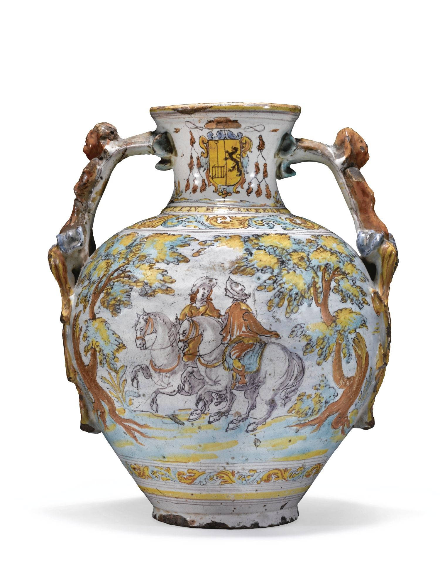 This jar comes from a celebrated series of jars, bowls and dishes made for the priors of the Escorial monastery over a short period from 1696 to 1723. No reason for this brief fashion has been found. The Reverend Father Juan de Santiesteban was prior from 1699 to 1705.