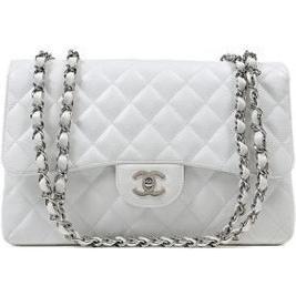 Alessandra Ambrosio wearing Chanel Jumbo 2.55 Flap Bag.