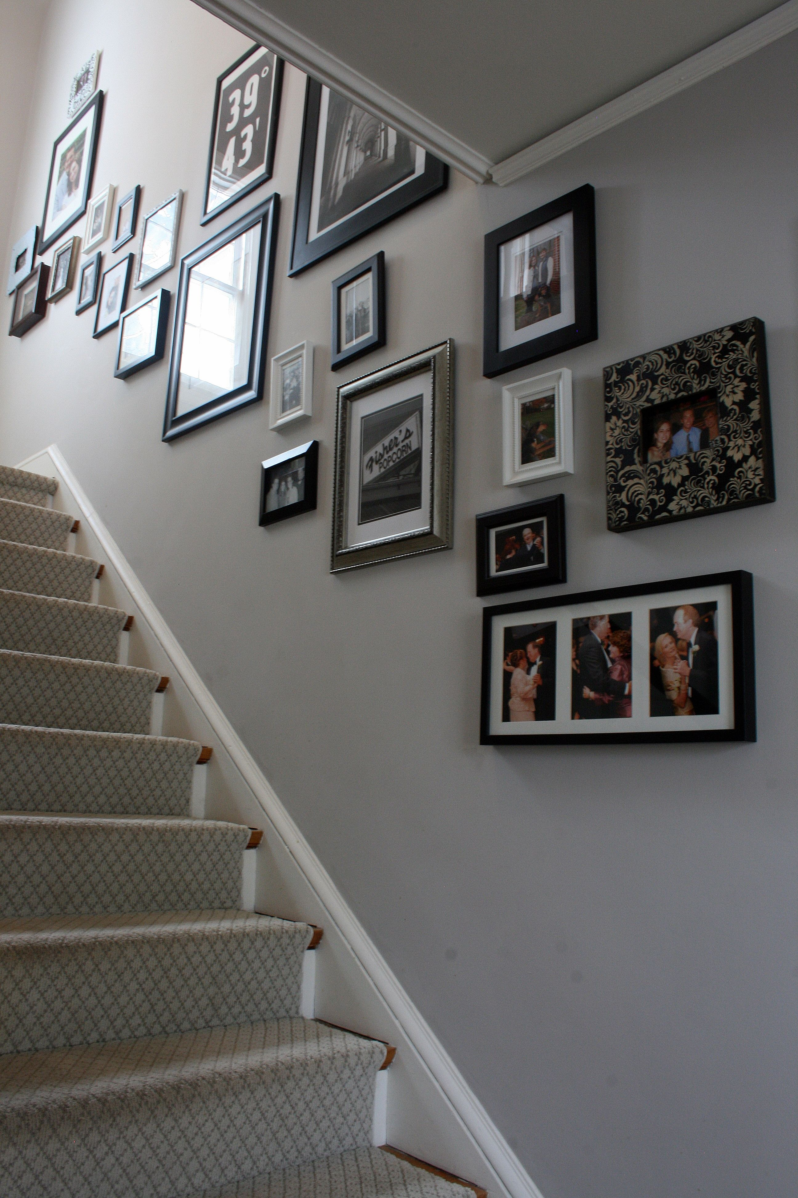 Cornforth White Center Hall With Photo Collage Stairs