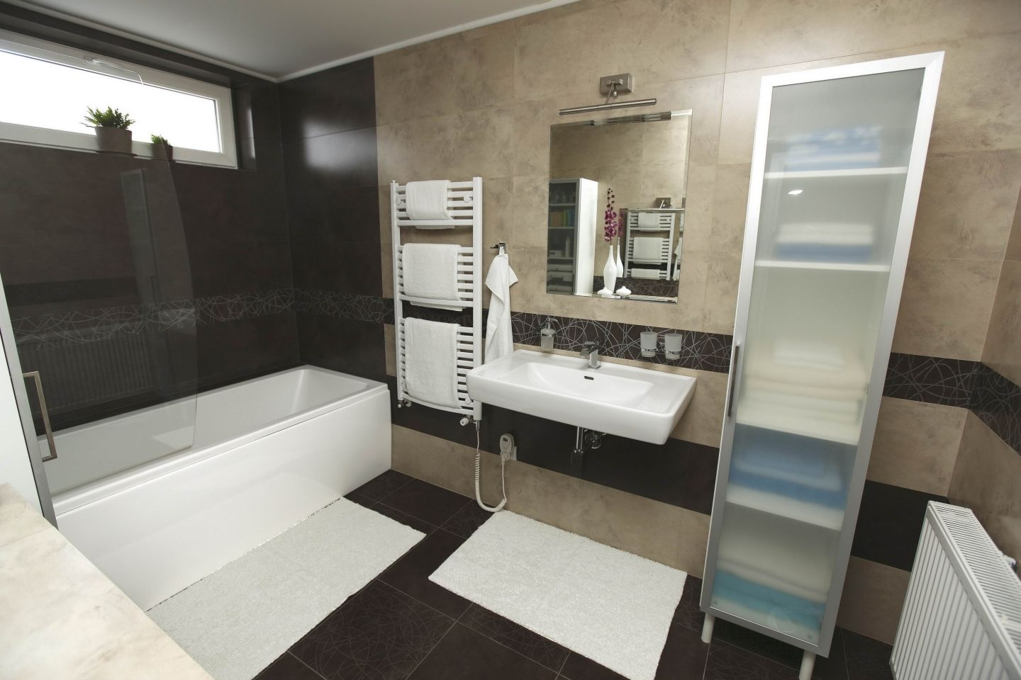 Small Bathroom In Beige And Brown With Tiling Black Floor White