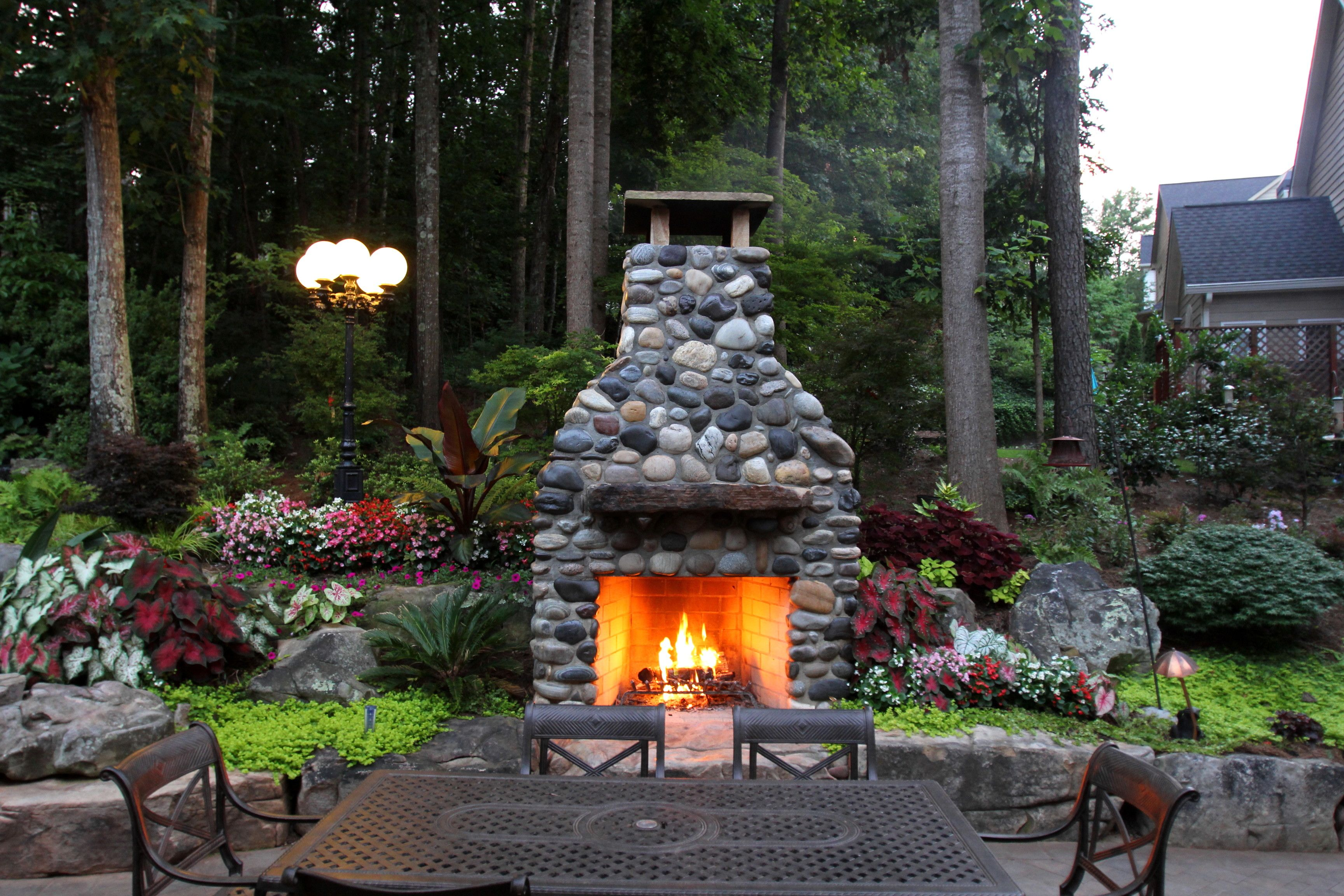 Outdoor fireplace made with montana river rock great for Where to buy outdoor fireplace