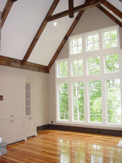 Beautiful And Bright White Living Room With Plenty Of Windows Cathedral Ceiling And Exposed Beams For This Mountain Custom Built Homes Cathedral Ceiling House