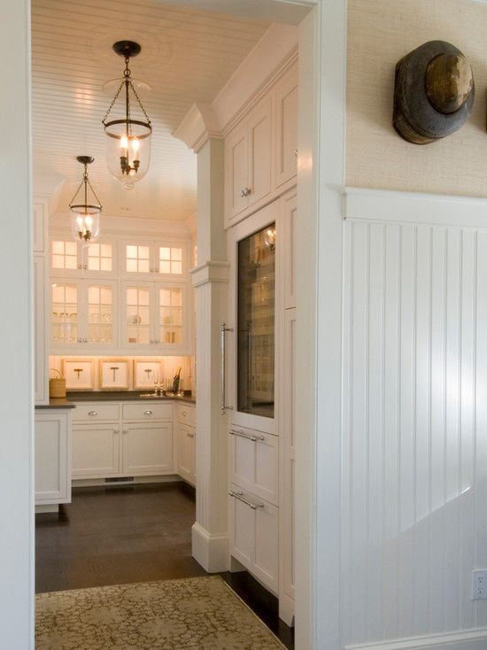 Elegant butlers pantry with built-in glass front wine ...