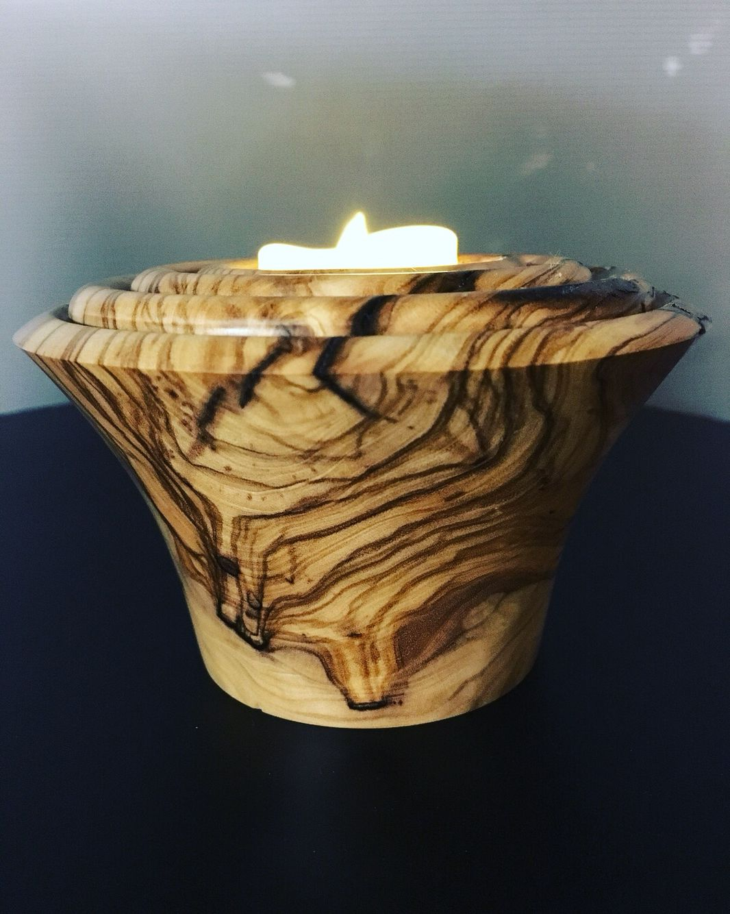 A tea light from a scrap of olive tree alr turned likes