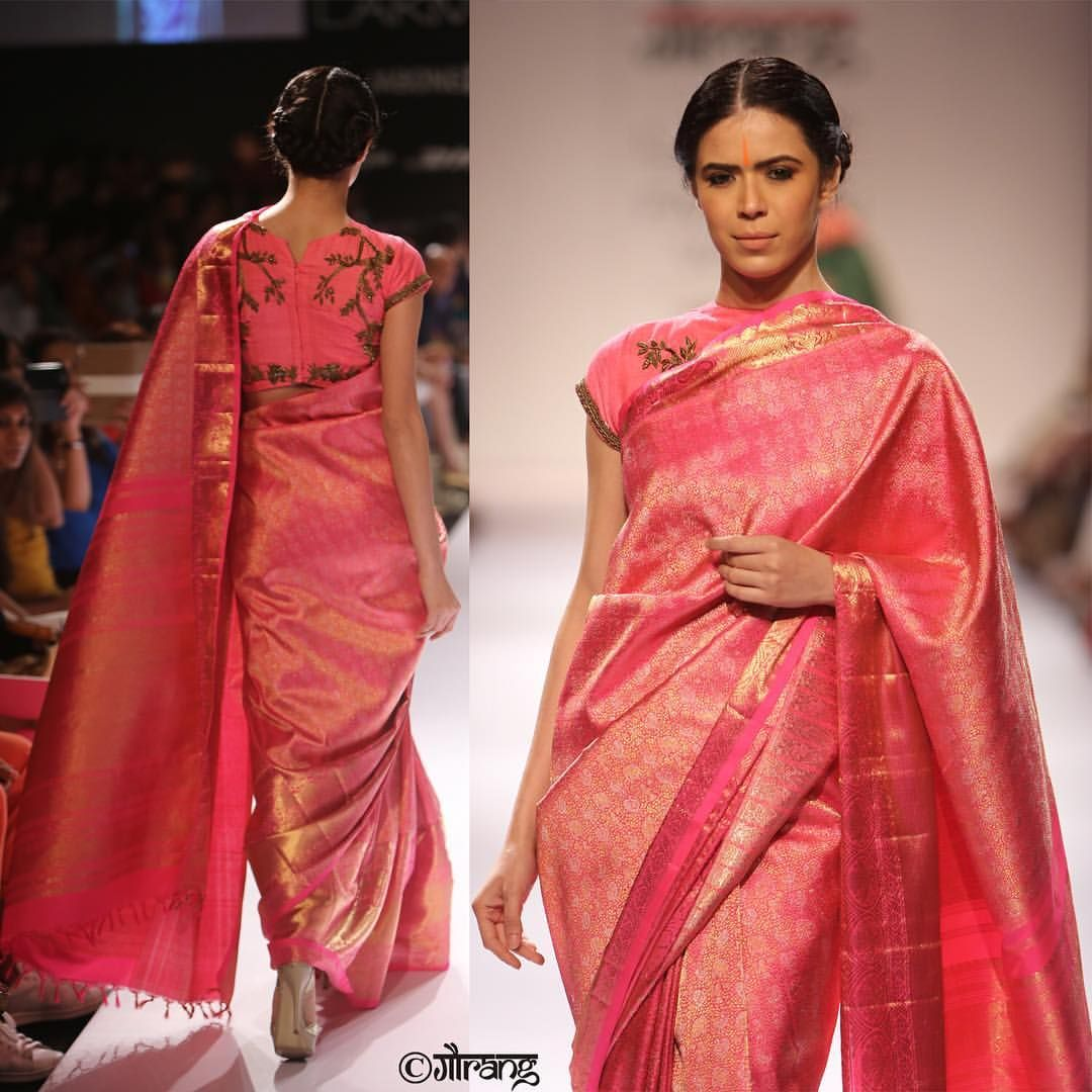 Motifs from the 16th century temple art gets a canvas on the pink kanjeevaram saree which is paired with a jungle inspired zardosi blouse.  GaurangShah  Gaurang  Handwoven  indianTextile  Textile  IndianWeave  Woven  kanjeevaram  kanchi  vayaweavingheritage