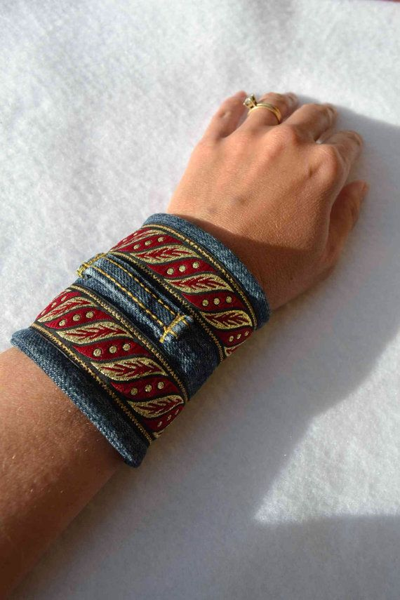 This is a one of a kind fabric cuff bracelet I made with gorgeous red and gold leaf ribbon and a pair of kids blue jeans, upcycled into this nature