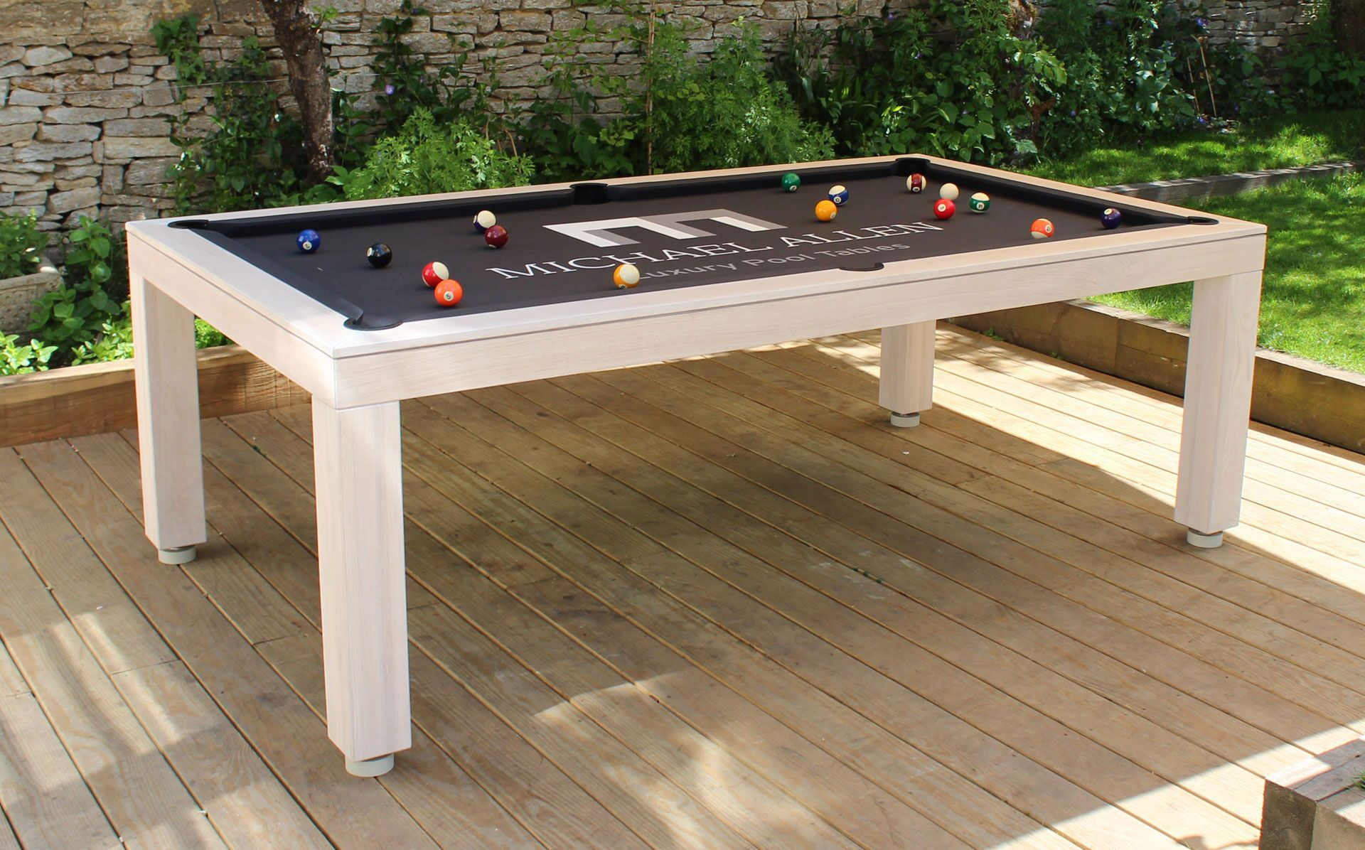 Outdoor Pool Table - Shown as a English Pool Table with a glass top in  colour (bleached Oak). Found
