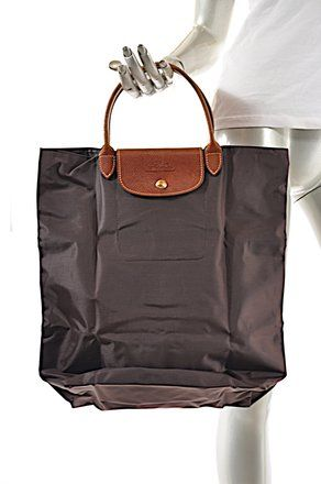 Get one of the hottest styles of the season! The Longchamp Foldable W Brown  Leather Handle Brown Nylon Tote is a top 10 member favorite on Tradesy. 12c1a1f701