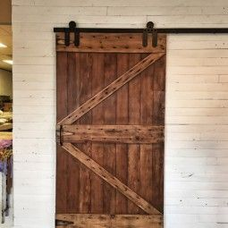 Barn wood door. Nice placement of distressed boards.