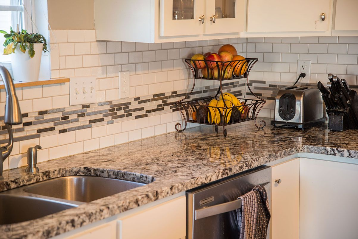 Lennco Granite Countertops And White Subway Tile Backsplash