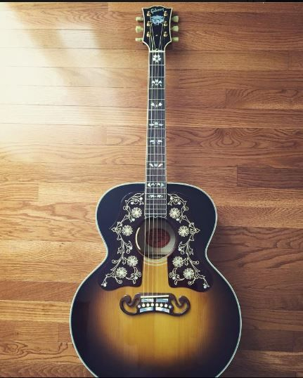 GIBSON GUITAR - Golden brown and black with lovely inlays. Photo via Aaron Steppe on Facebook.