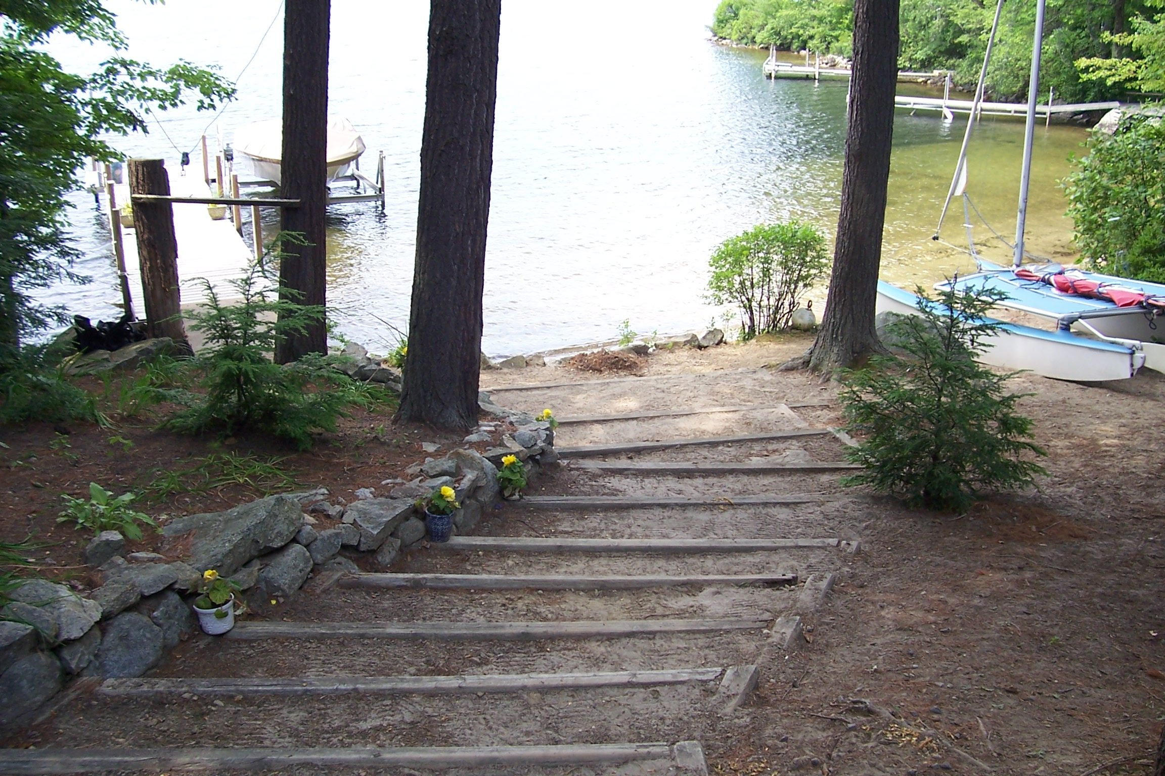 Wood framed steps to lake, entrance to lake. | Side yard ... on Lakefront Patio Ideas id=47176