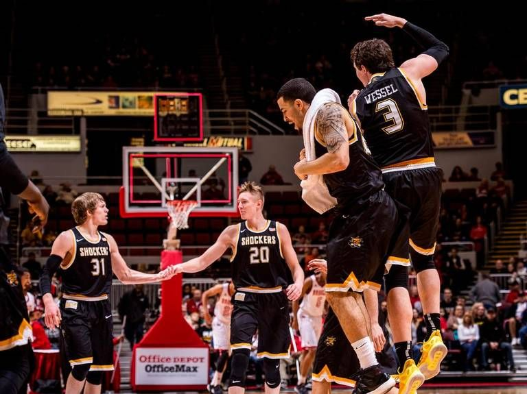 to with VanVleet  Wichita jumps celebrate Fred State guard