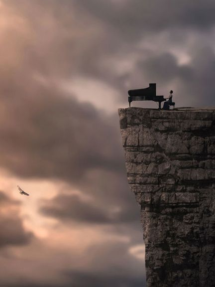 Great Photo Of A Guy Playing A Piano On The Edge Of A Cliff