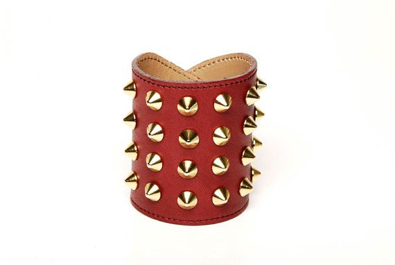 """""""Leather Cone Cuff"""" - a red leather and gold spiked cuff. (Shop: http://www.etsy.com/shop/pollyanatorres)"""