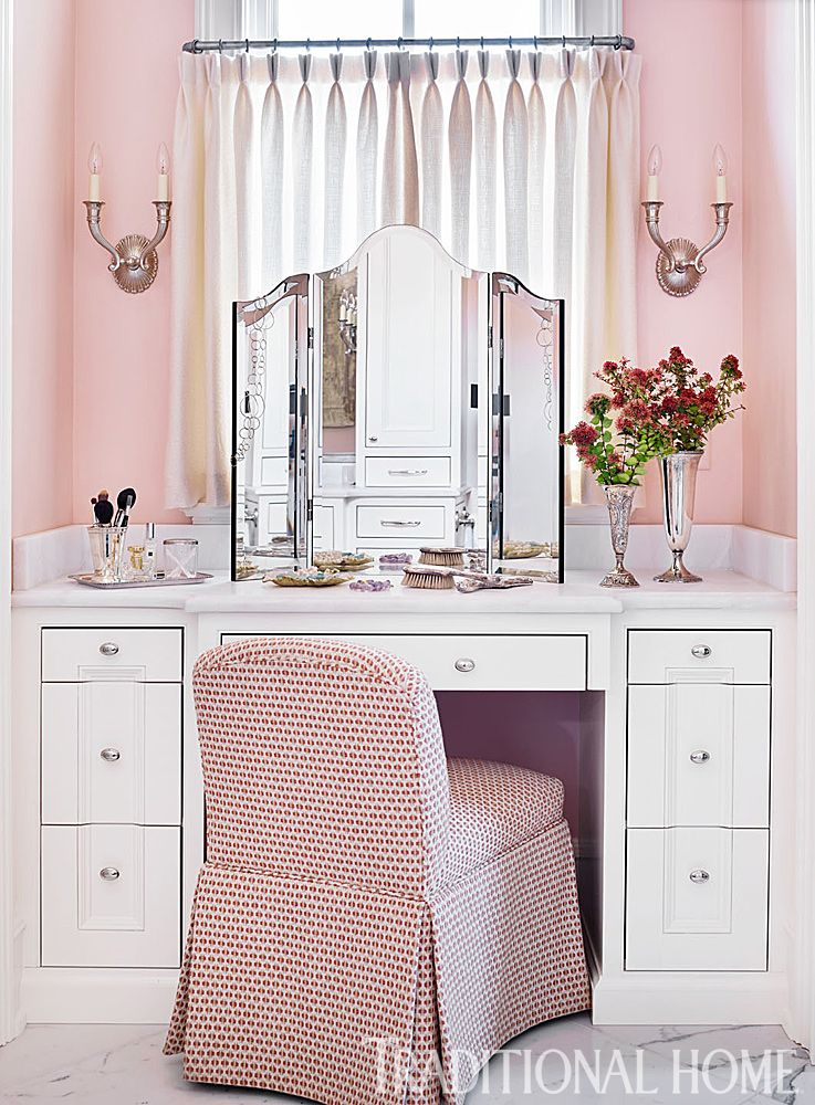 Built In Vanities a vanity table was built into a niche with a north-facing window