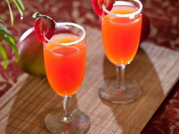 1 bottle chilled Prosecco   1/2 oz. Limoncello   1/2 oz. vodka   1/2 oz. Cointreau   Dash of grenadine, for color   Maraschino cherry