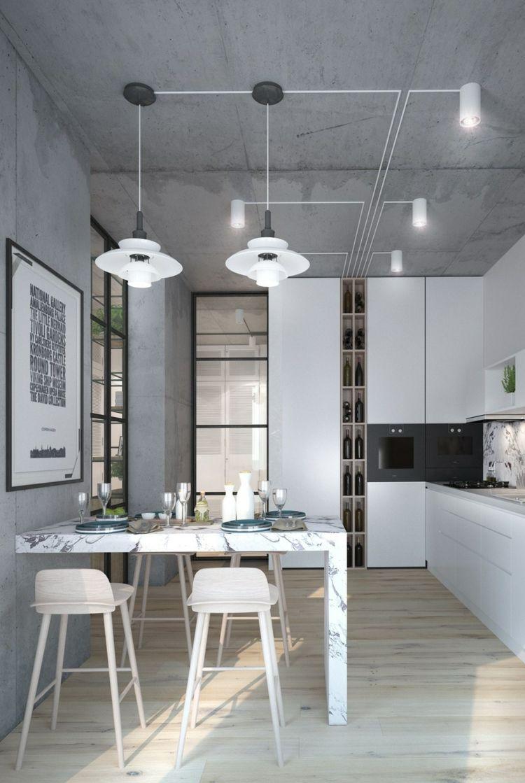 Küche in Weiß eingerichtet mit Wänden und Decke in Beton-Look | AU ...