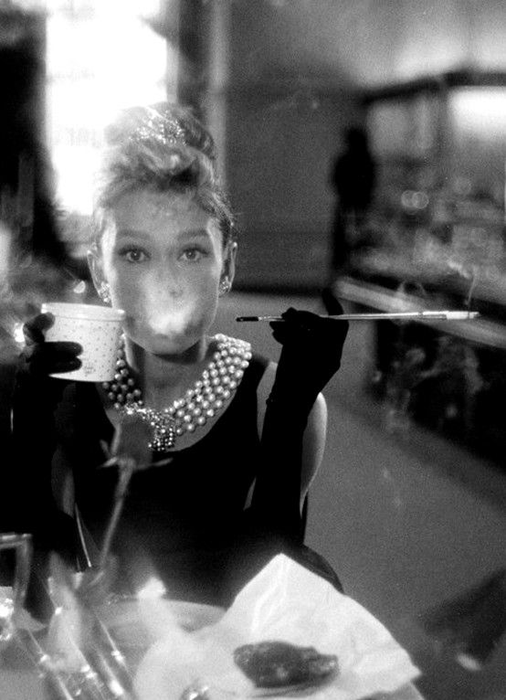 0a3fa42a17bf Audrey Hepburn blowing smoke in BREAKFAST AT TIFFFANY S.