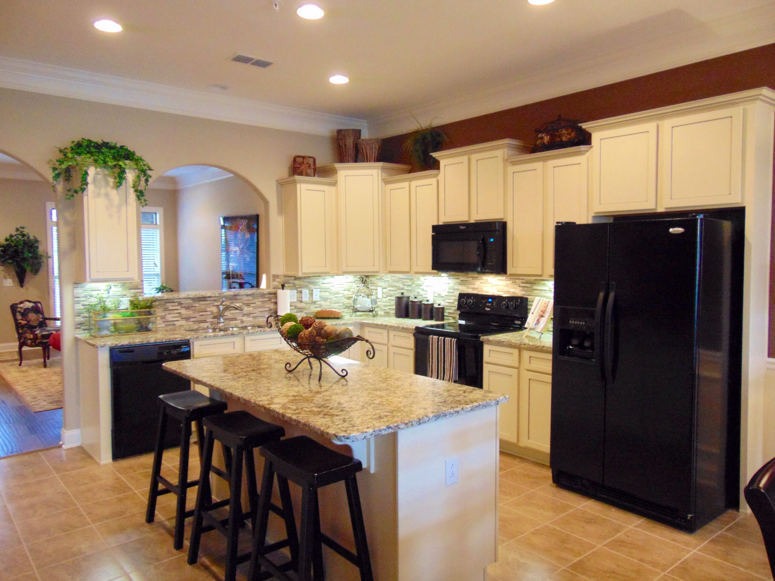 Stunning Model Home Kitchen By Ole South Showcasing Staggered Height Vanilla Glazed Cabinets W Cabinets With Crown Molding Model Home Decorating Home Kitchens