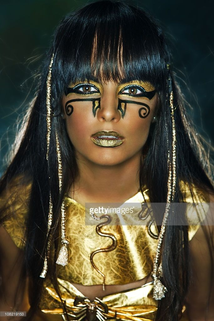 Girl Wearing Gold Costume and Face Painted MakeUp