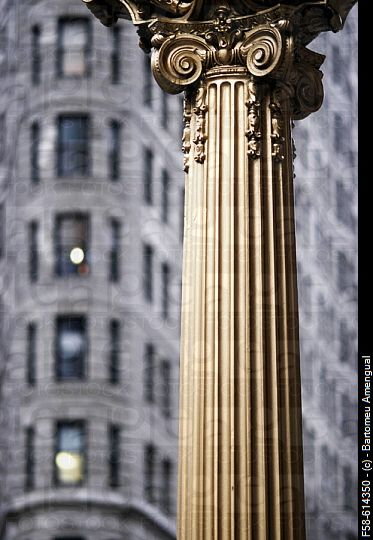 NYC Corinthian column with Flatiron Building in background, via