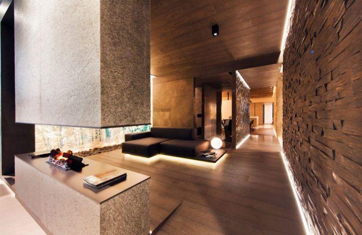 Indirekte Beleuchtung Wandgestaltung Wohnzimmer Braun Holz Naturstein