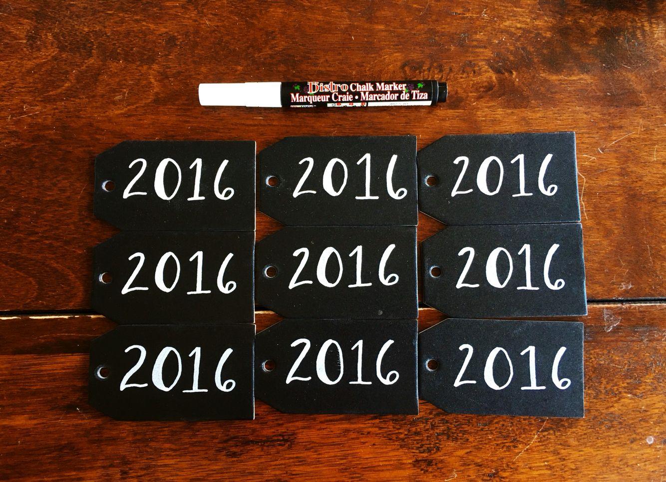 Chalkboard tags for a mason jar centerpiece graduation party
