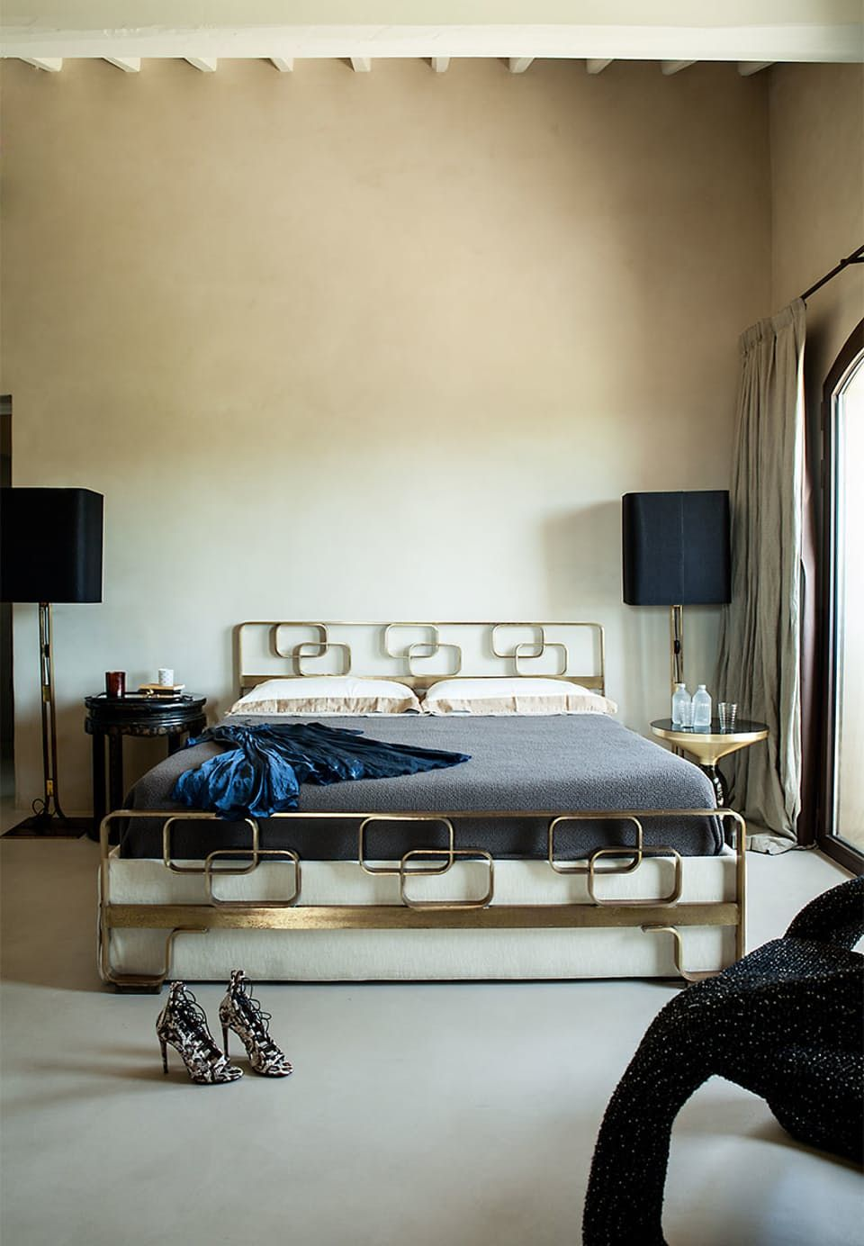 Beautiful art deco-inspired bedroom with a wonderful sculpted brass bed and  vintage floor lamps
