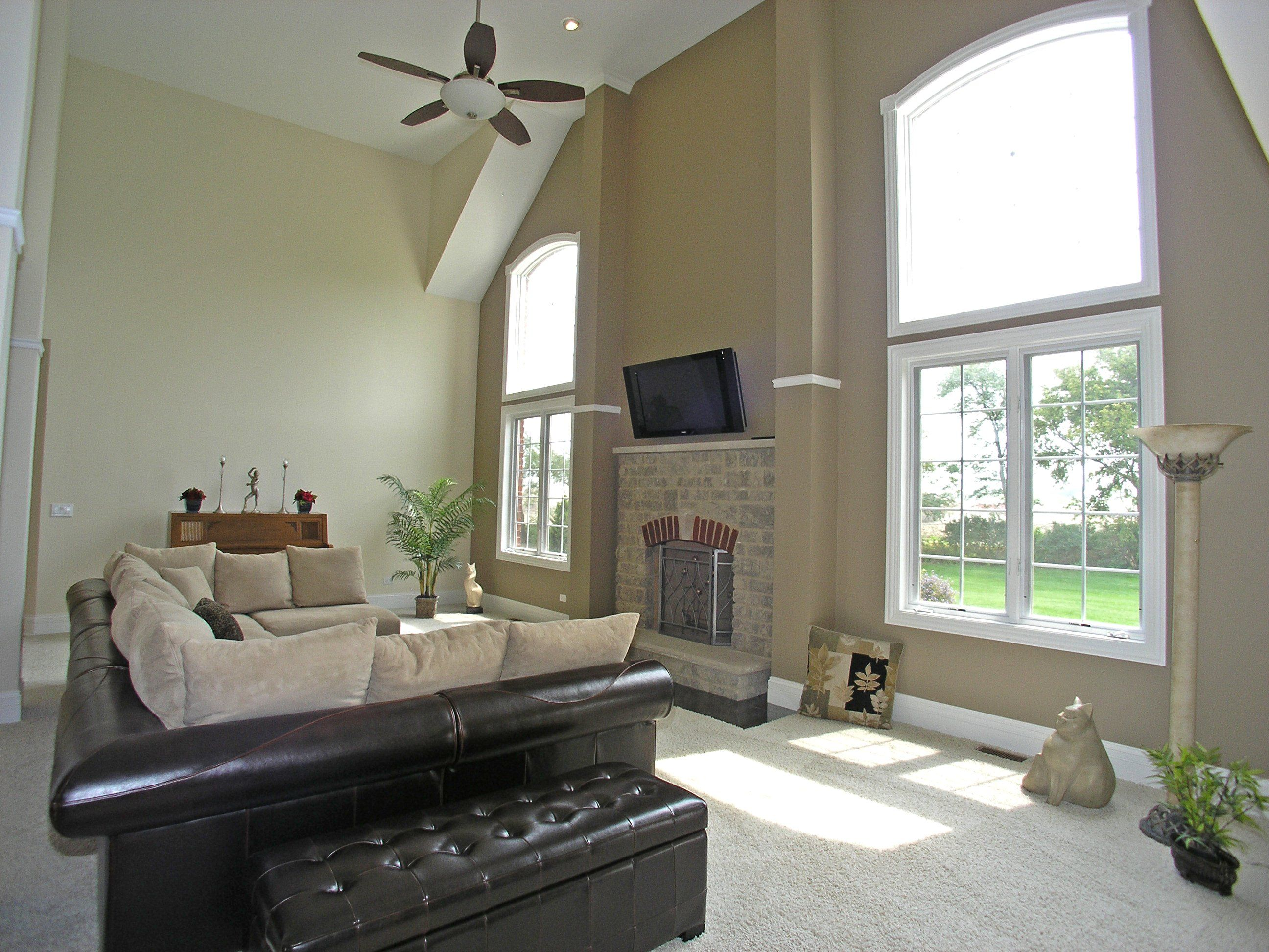 nice neutral great room with high ceilings large picture windows