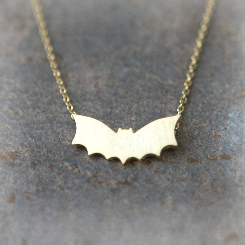 Flying Bat necklace in gold. $15.00, via Etsy.