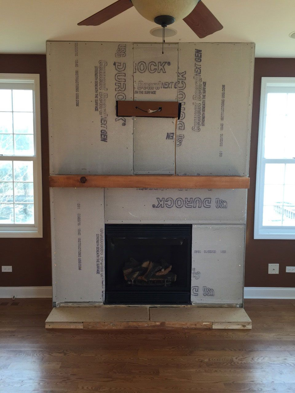 A step-by-step DIY stone veneer installation on a fireplace. In only