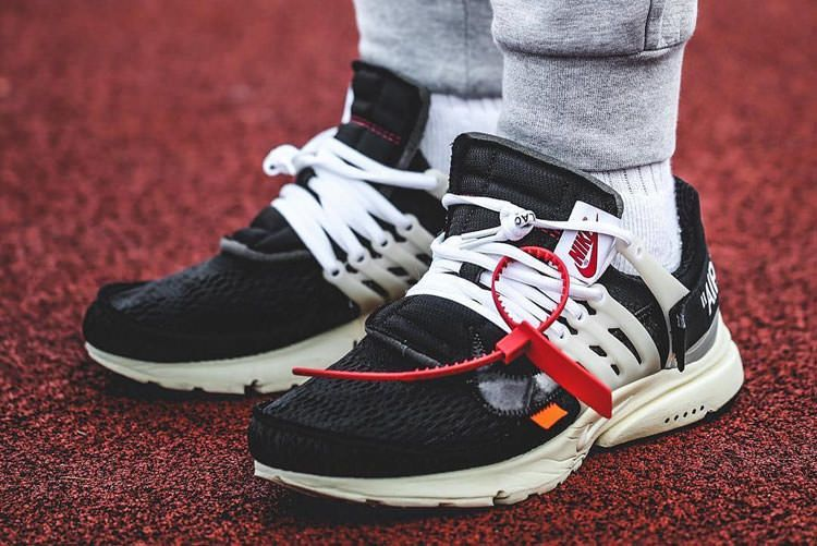 OffWhite x Nike Air Presto THE TEN with black as the main color with  eyecatching orange embellishment bringing a strong visual impact