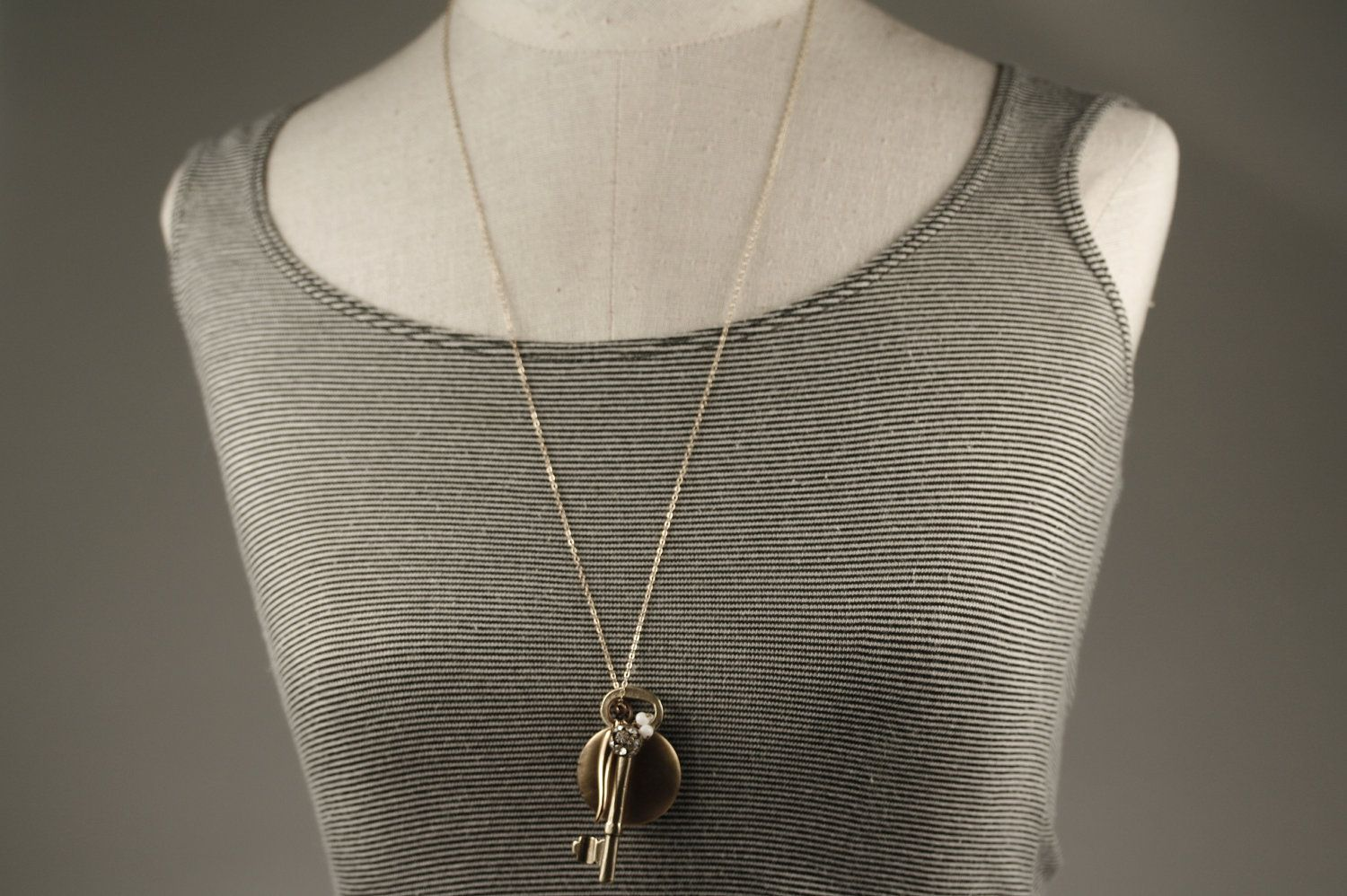 Vintage Locket and Key Charm Necklace, Gold Horn Pendant, Rhinestone Ball, 14kt Gold Filled Chain. $74.00, via Etsy.