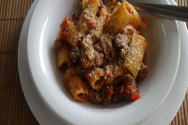 Goulash/American Chop Suey by the Frugal Chef-----this variation is made with sweet Italian sausage and peeled/finely diced fresh tomatoes along with tomato paste and tomato sauce.  Yum