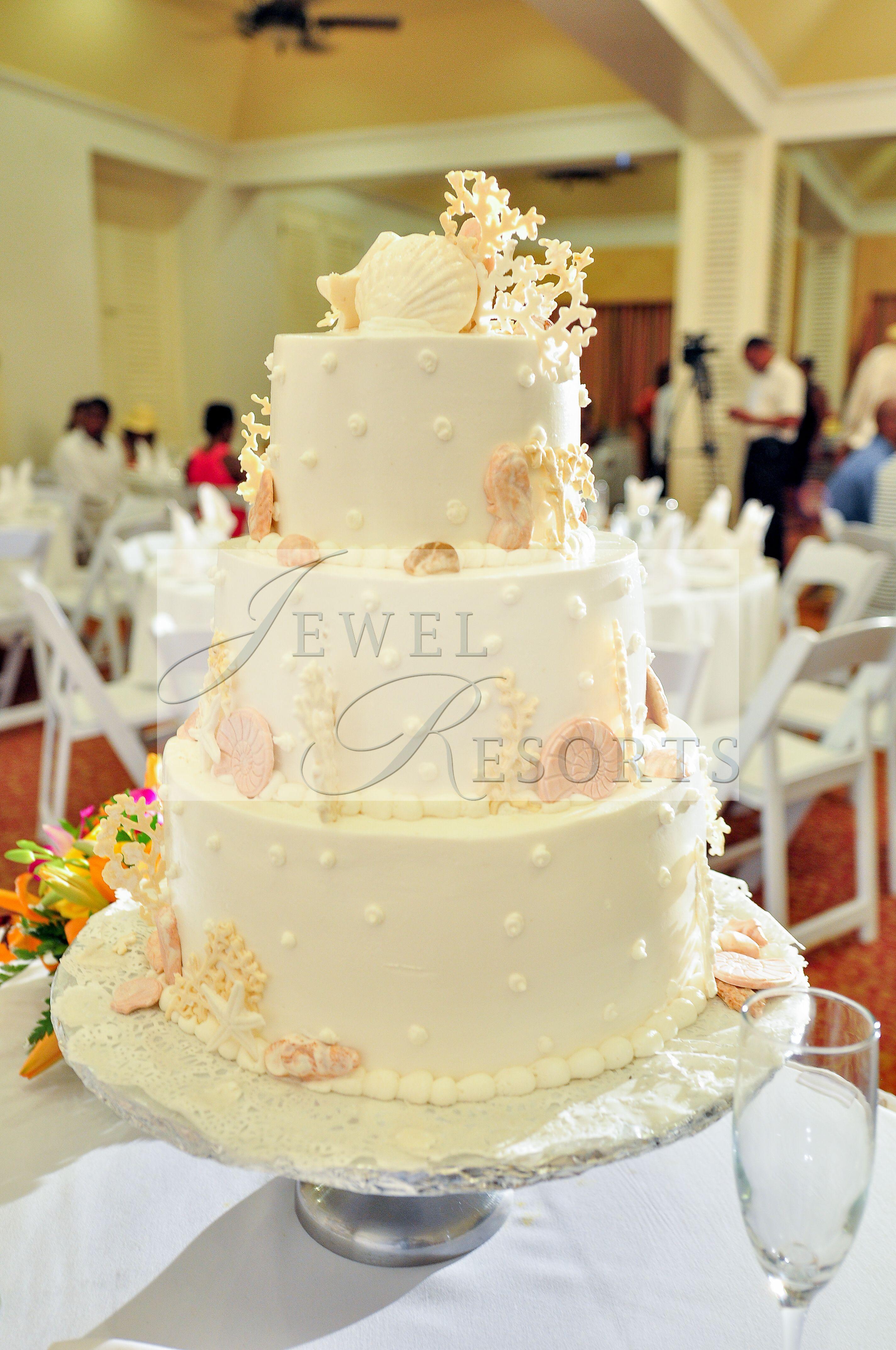 Custom beach inspired wedding cake at jewel resorts