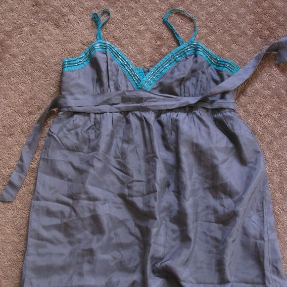 Gray Dress Cute knee length dress with teal trim with beading. Very cute, comfortable and flirty. It will look great this summer with some flats. Smoke free home. NWOT  Make me an offer, items can be bundled at your request. Heritage 1981 Dresses