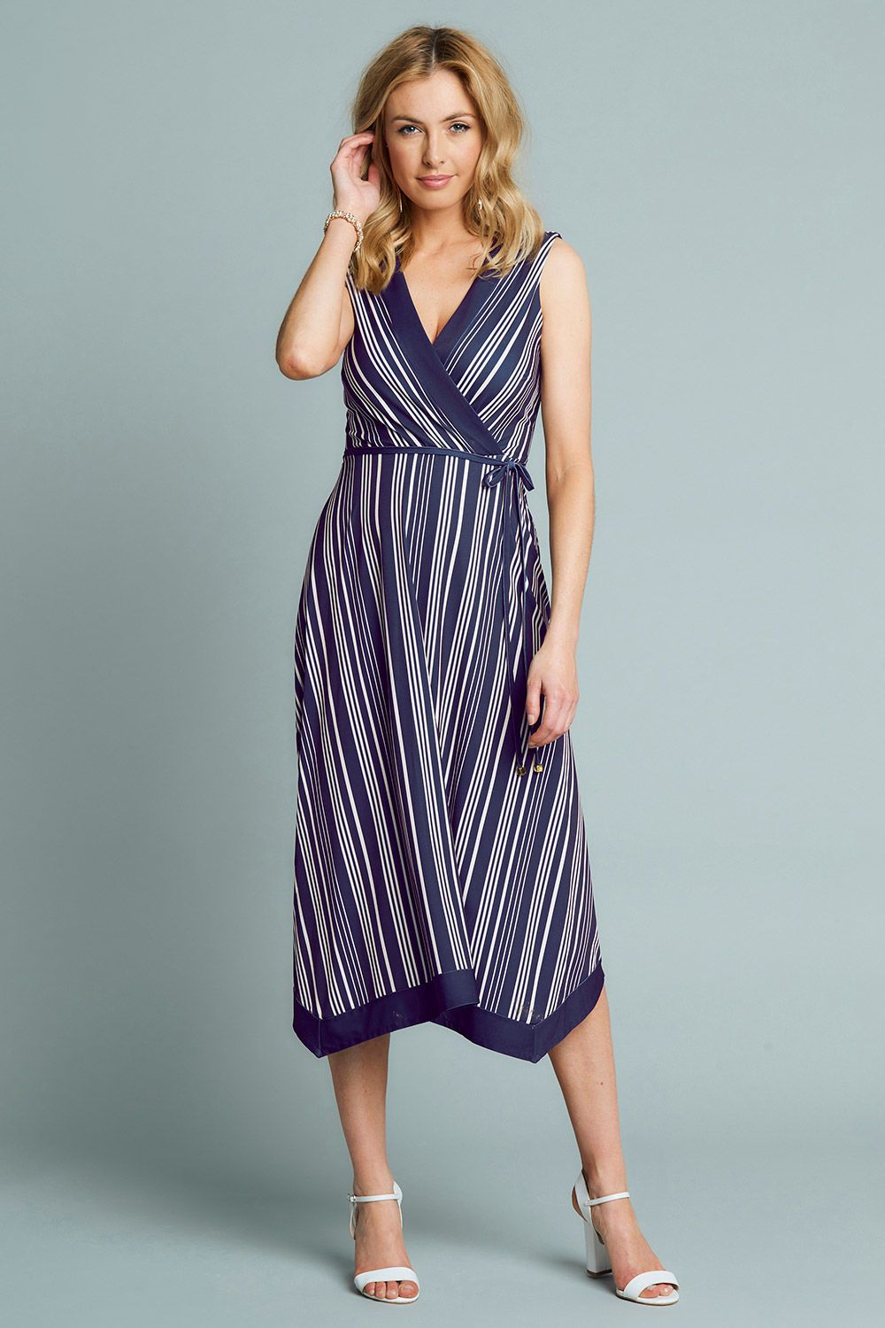 9899fc4976e Striped Wrap Hanky Hem Dress - The clever use of vertical lines sweep  across and down the body to create an optical illusion of making you look  taller and ...