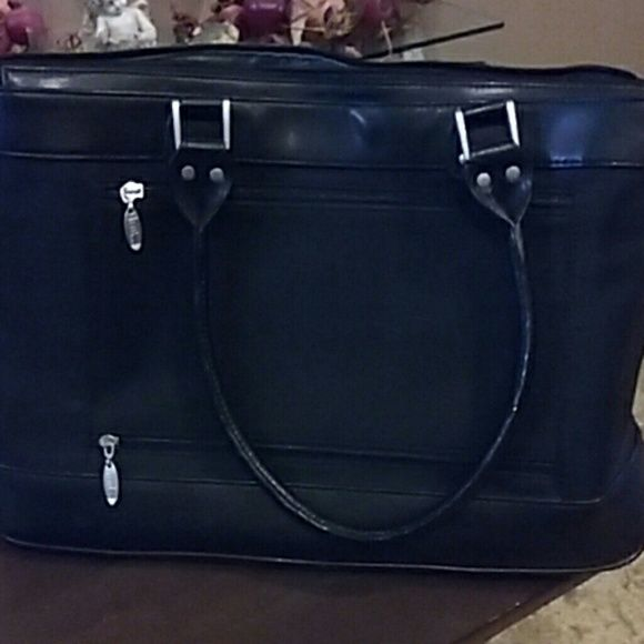 Laptop  bag, very nice roomy and diff compartments Part leather  n part  soft material make me an offer. Bags Laptop Bags
